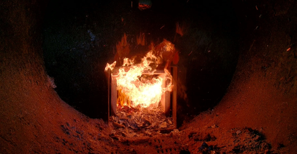 Biomass flame inside the fire chamber of the outdoor furnace