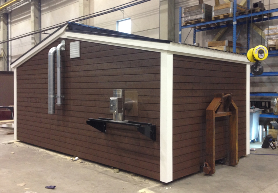 Containerised biomass boiler plant with wood cladding