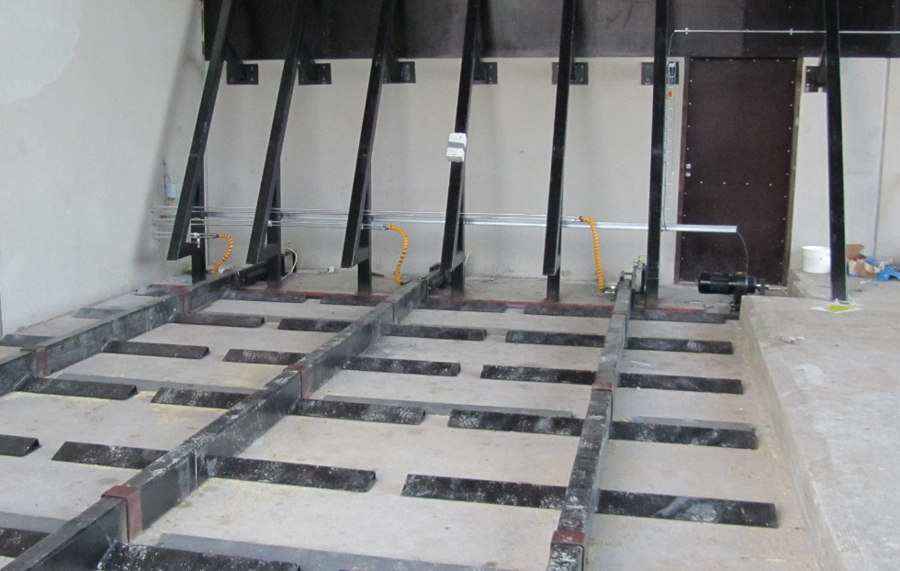 Hydraulic scrapers installed on a concrete floor
