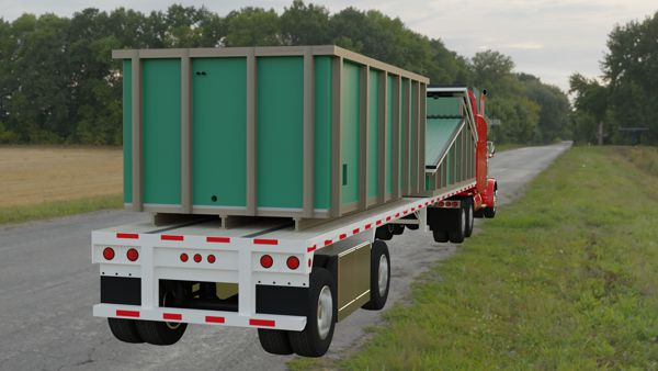 BioCont Jumbo containerised biomass heating plant on a semi-truck flatbed trailer.