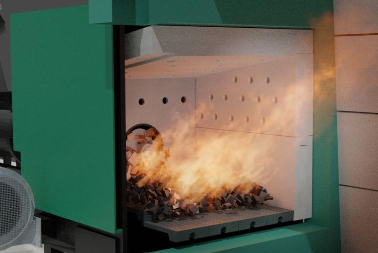 Vue intérieure d'un brûleur biomasse Säätötuli. La flamme sort du brûleur vers la chambre de combustion à l'intérieur de la bouilloire.