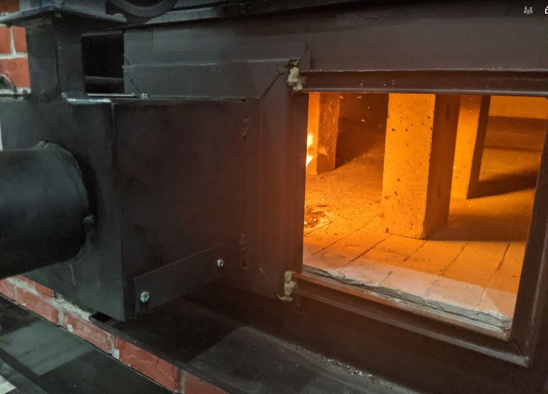The biomass burner shoots its flame inside the bread oven